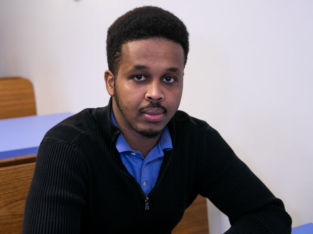 Lansing resident Farhan Sheikh-Omar poses for a portrait in Lansing March 13, 2020. Sheikh-Omar has been a vocal advocate of his friend Uwimana Gasito in his struggle with ELPD in an incident of excessive police force.