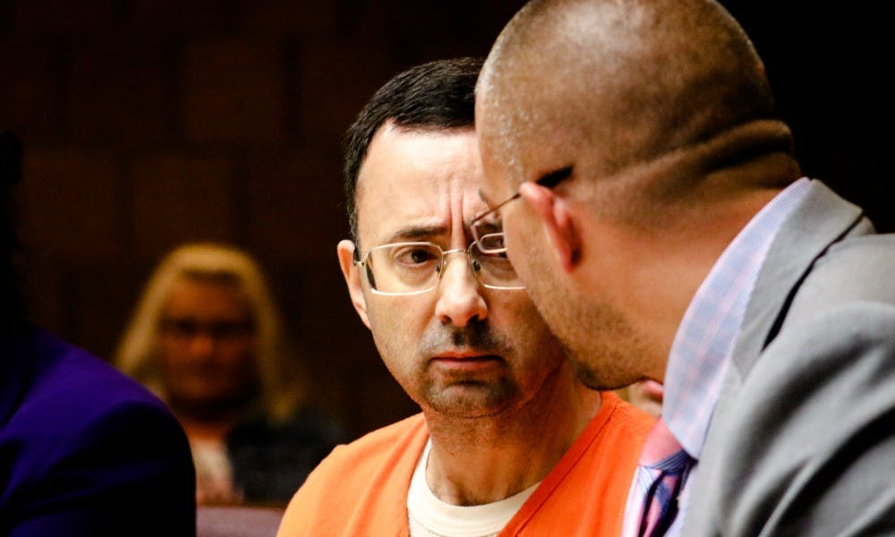 Larry Nassar looks at his defense attorney Matt Newburg during the final day of the preliminary examination hearing in the 55th District Court on June 23.