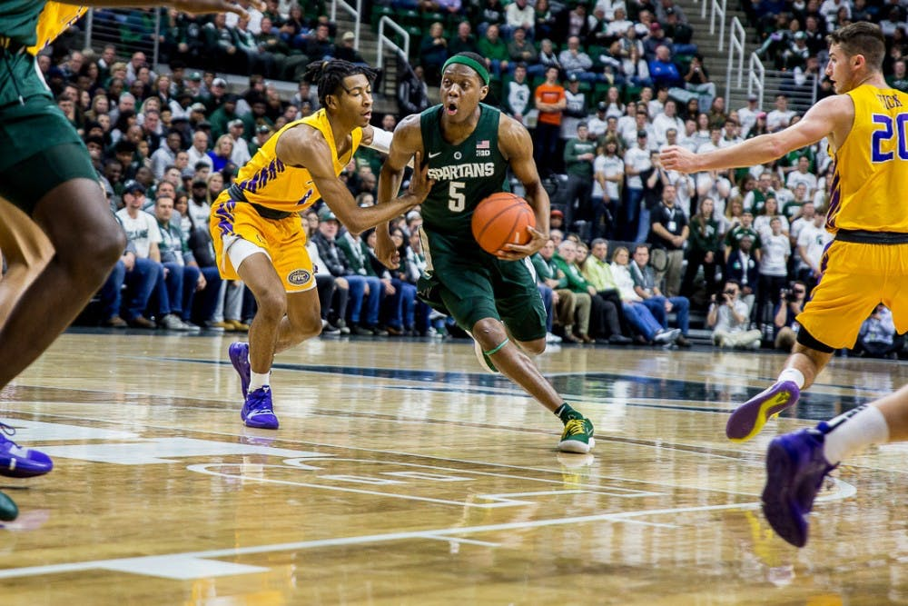 Junior guard Cassius Winston (5) drives the ball towards the net during the game against Tenessee Tech on Nov. 18, 2018 at the Breslin Center. The Spartans were ahead, 42-14 at halftime.