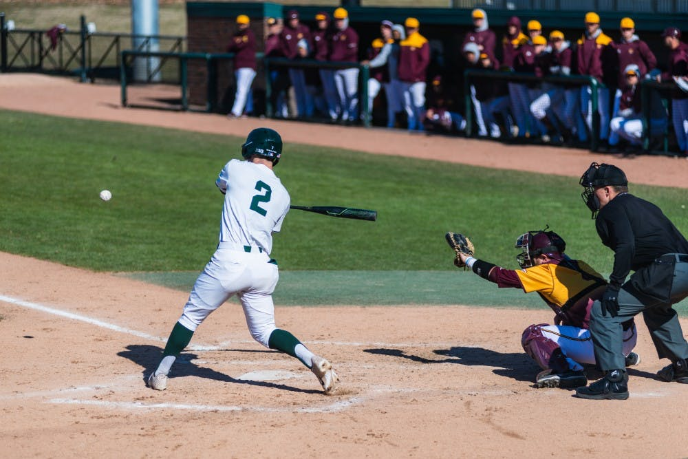 <p>Senior Marty Bechina swings at a pitch against Central Michigan. The Spartans lost to the Chippewas, 6-8, at McLane Baseball Stadium on April 3, 2019.</p>