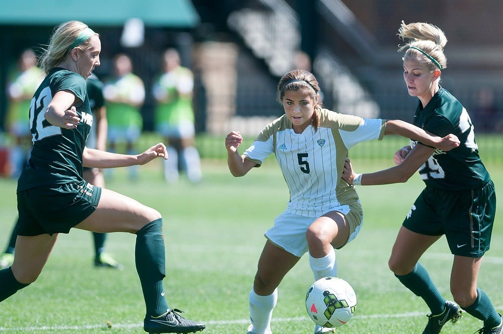 <p>Freshman midfielder Morgan McKerchie attempts to steal the ball from Western midfielder Ariana Donahue on Sunday at DeMartin Stadium at Old College Field during a game against Western Michigan University. The Spartans defeated the Broncos, 3-2 in double overtime. Aerika Williams/The State News.  </p>