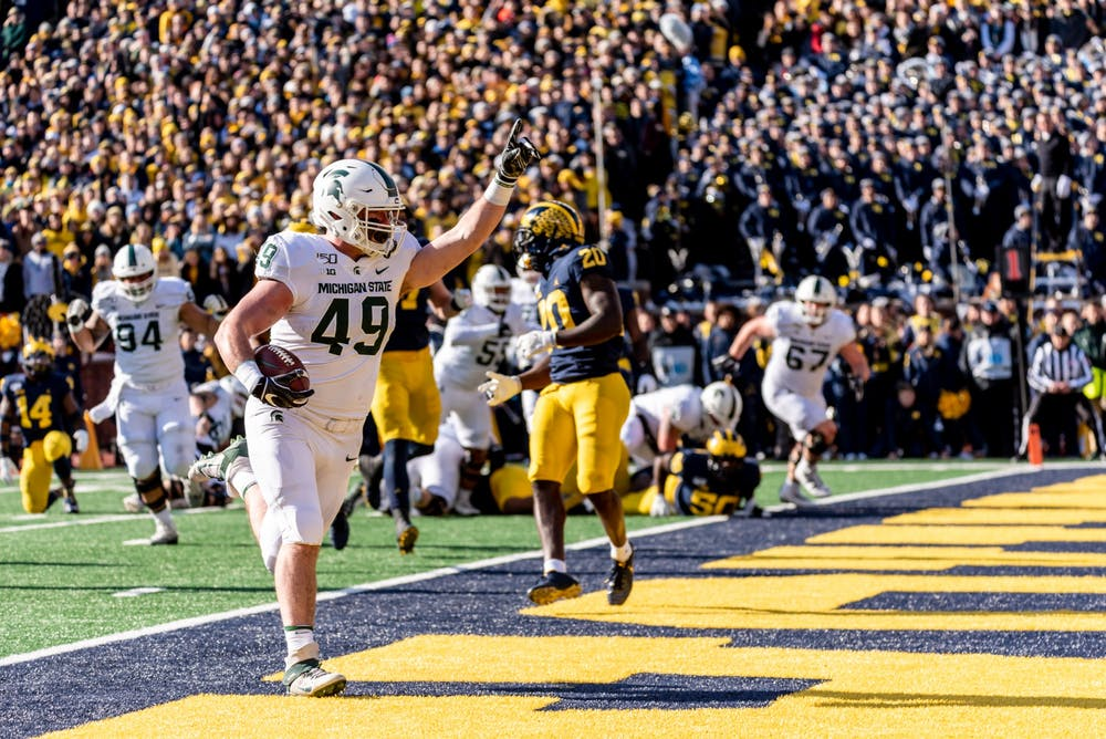 Sophomore fullback Max Rosenthal (49) scores a touchdown against Michigan. The Spartans fell to the Wolverines, 44-10, at Michigan Stadium on November 16, 2019.