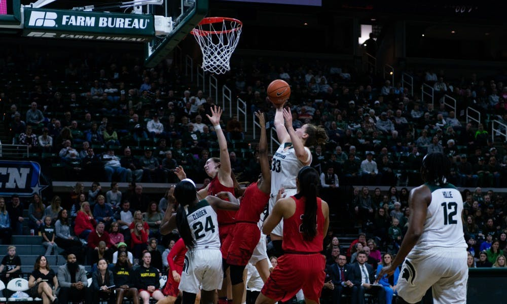 <p>Senior Jenna Allen steals a rebound away from several players during the game against Maryland at the Breslin Center on Jan. 17, 2019. The Spartans defeated the Terrapins, 77-60.</p>