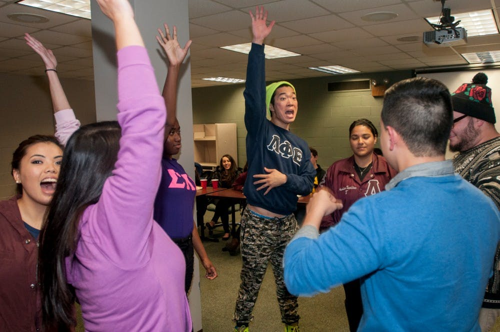 <p>Hospitality business senior Dong Jun Lee and other members of the Multicultural Greek Council e-board play trivia together on Nov. 12, 2014, at the Student Services Building. Lee's organization Lambda Phi Epsilon and other greek organizations all came together for a game night event. Raymond Williams/The State News</p>