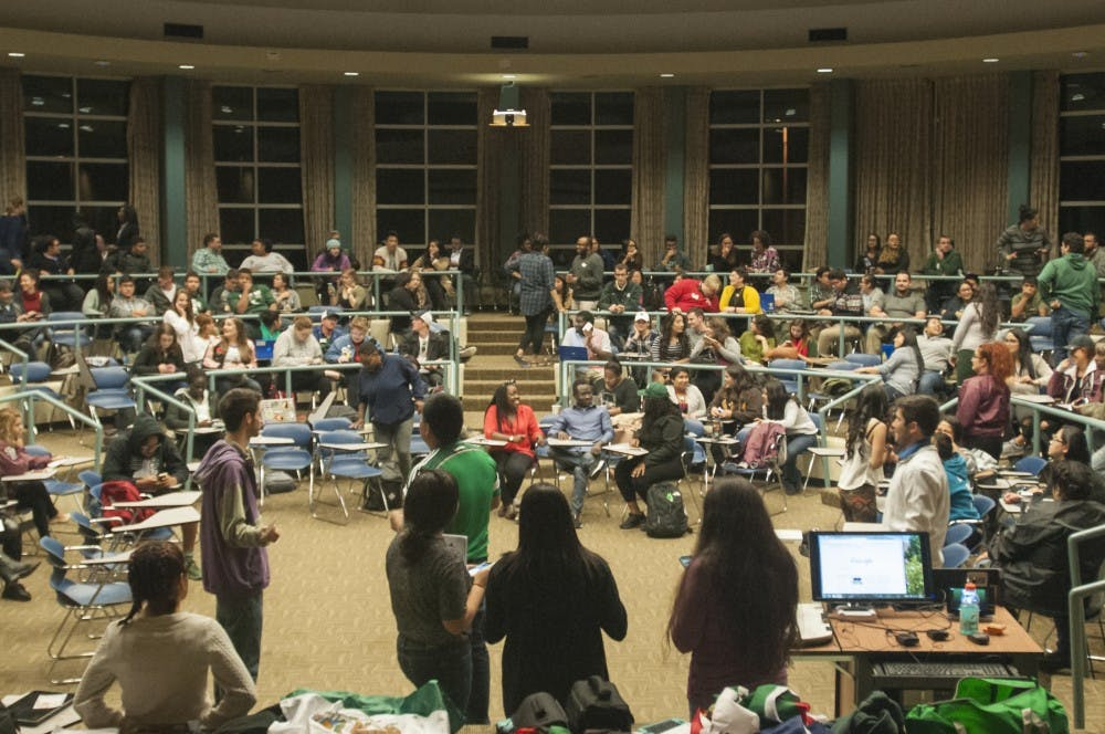 People sit and talk before the Latinx Students In Need of Solidarity Town-Hall on Oct. 13, 2016 in the Erickson Hall Kiva. The town-hall, hosted by Culturas de las Razas Unidas, included emotional stories from students who had experienced racism.