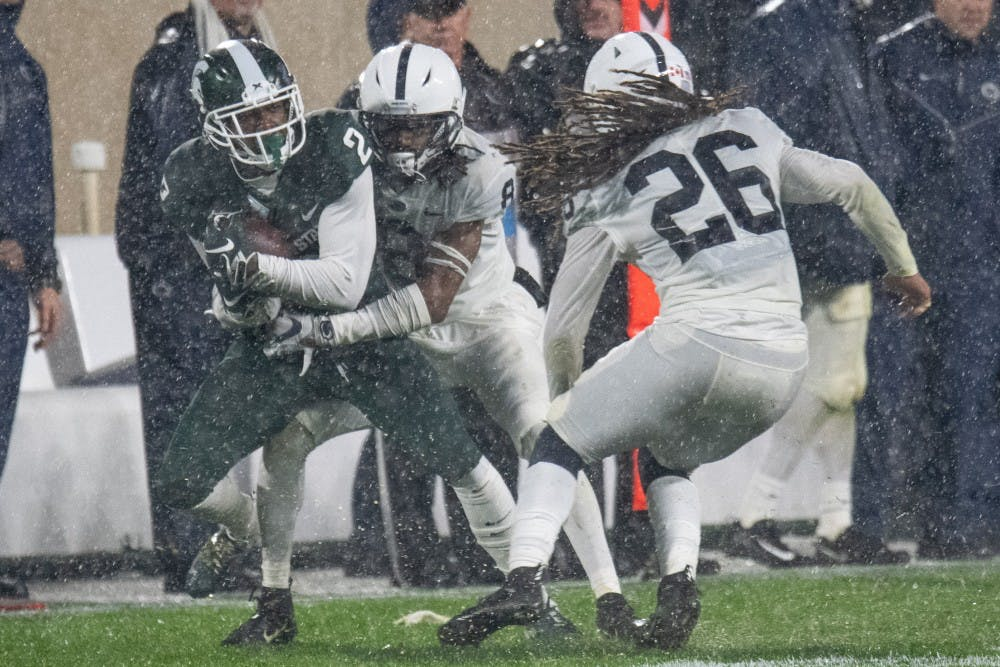 <p>Freshman wide receiver Julian Barnett (2) is tackled during the game against Penn State on Oct. 26, 2019 at Spartan Stadium. The Spartans fell to the Nittany Lions, 28-7.</p>