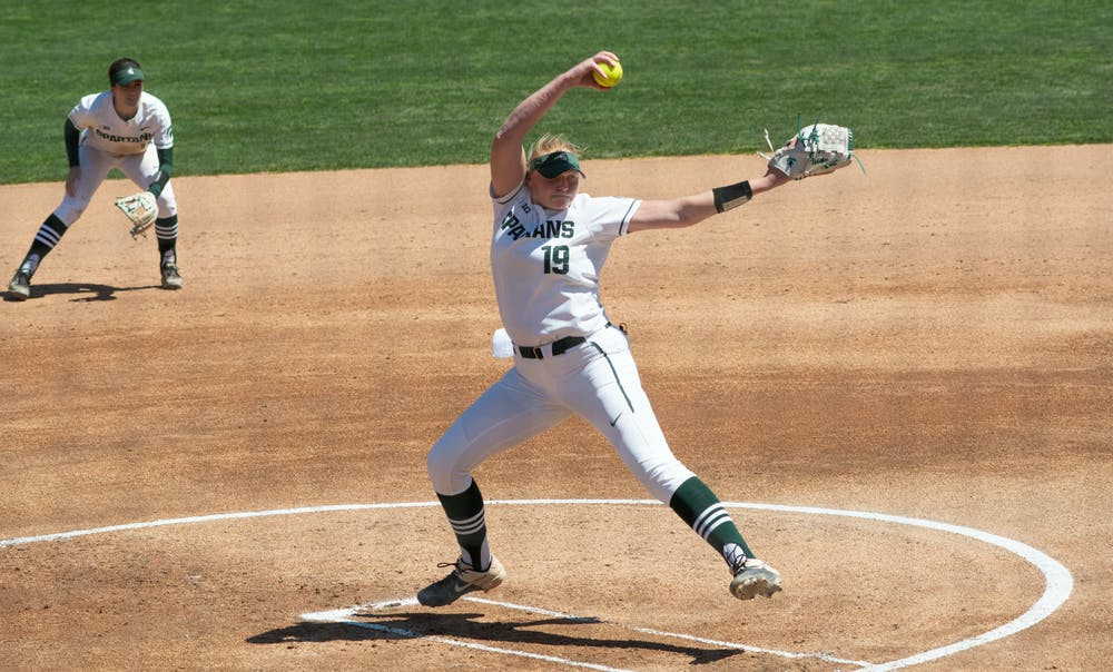 Michigan State's pitcher Alli Walker (19) pitches the ball in the Spartans' win over Purdue on April 25, 2021.