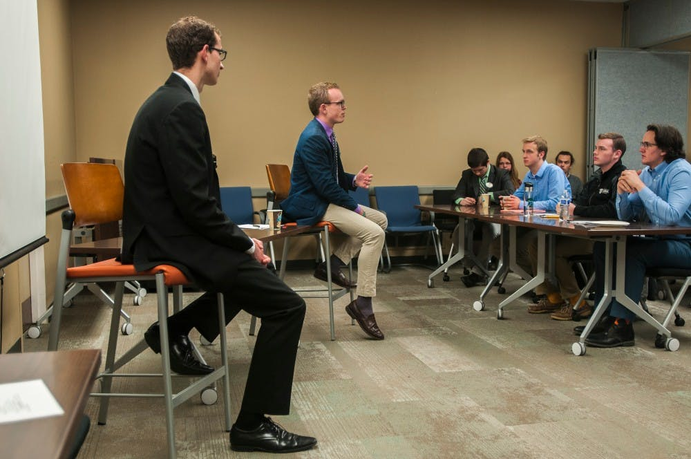 Political theory and constitutional democracy and international relations sophomore Lorenzo Santavicca, left, political theory and constitutional democracy junior Bryn Williams, right, debate for ASMSU office of the President on April 13, 2016 at Student Services Building.