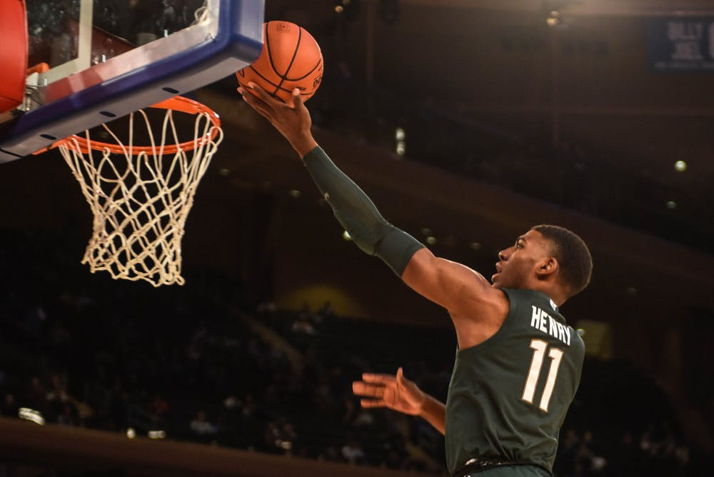 Sophomore forward Aaron Henry (11) shoots the ball during the game against Kentucky at the State Farm Champions Classic at Madison Square Garden on Nov. 5, 2019. The Spartans fell to the Wildcats, 69-62.