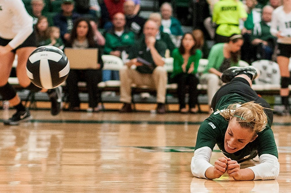 <p>Junior libero Kori Moster dives for the ball during the game against Michigan on Oct. 23, 2013, at Jenison Field House. The Spartans lost, 3-1. Khoa Nguyen/The State News</p>