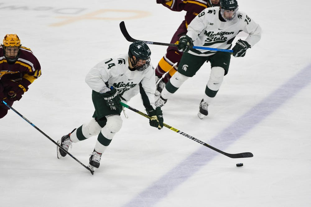 Sophomore forward Adam Goodsir (14) receives a pass during the hockey game against Minnesota at the Munn Ice Arena on January 10, 2020. The Spartans defeated the Golden Gophers 4-1.