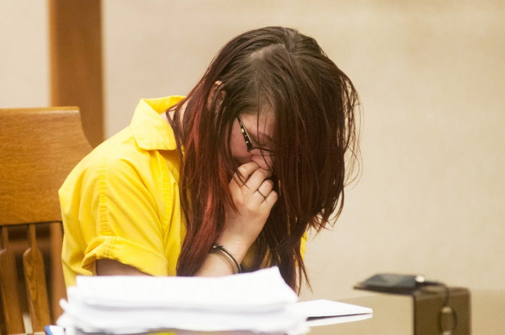 <p>Samantha Grigg gets emotional during her sentencing hearing May 27, 2014, at Clinton County Circuit Court, 100 Michigan 21, in St Johns, Mich. Grigg was sentenced to 6 to 15 years in prison after pleading guilty to manslaughter in the death of MSU student Dustyn Frolka. Hayden Fennoy/The State News</p>
