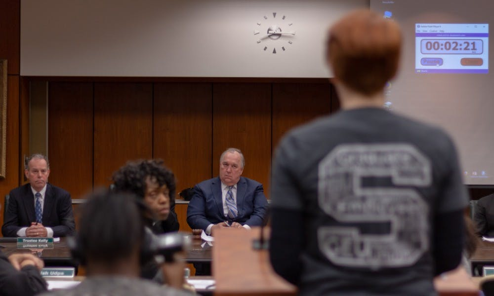 <p>Interim President John Engler listens to MSU Student Shawna Rowe as she shares another student&#x27;s sexual assault story.</p>