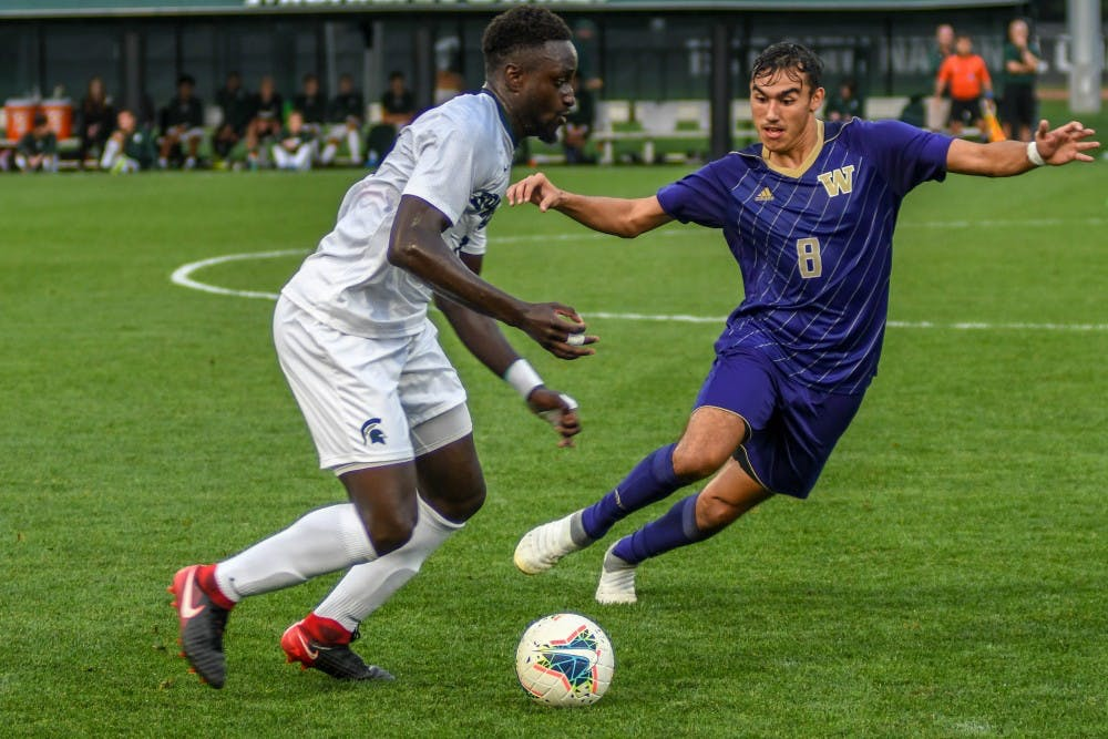 <p>Senior defender Michael Wetungu (17) fights for the ball against Washington's forward Gio Miglietti (8) during the game against Washington on Sept. 6, 2019. The Spartans fell to the Huskies, 0-1.</p>
