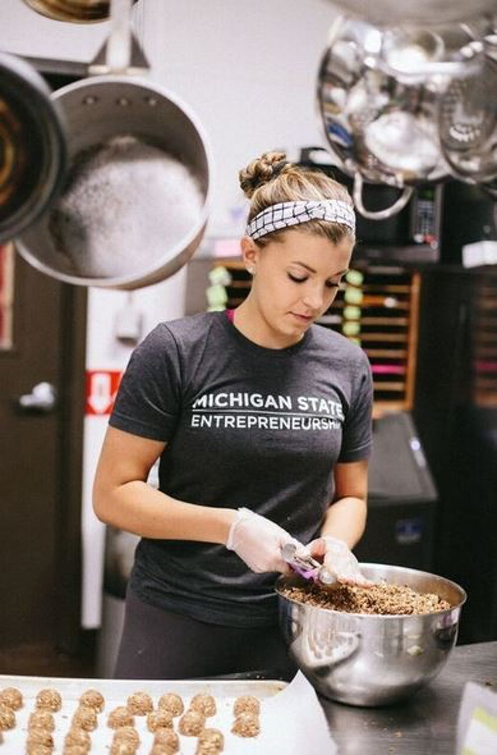 "<p>Kinesiology junior Brianna Makaric is the&nbsp;founder of ""BRITE bites,"" a probiotic snack company. She is one of the two MSU students chosen for a prestigious entrepreneurial fellowship program. Photo courtesy of the Eli Broad College of Business.</p>"