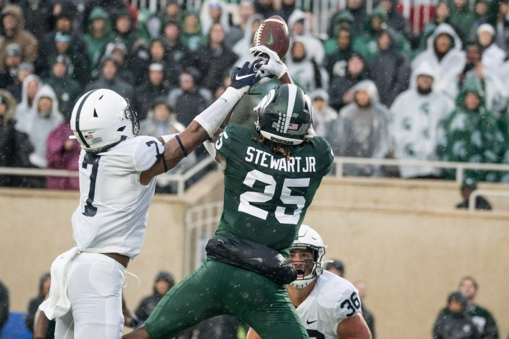 <p>Senior wide receiver Darrell Stewart Jr. (25) tries to bring in a pass in the end zone during the game against Penn State Oct. 26, 2019 at Spartan Stadium. The Spartans fell to the Nittany Lions, 28-7.</p>