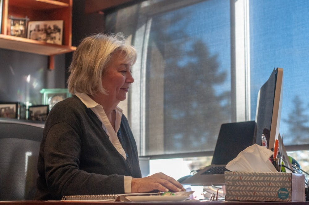 <p>State News General Manager Martha Sturgeon works on her computer Dec. 4.&nbsp;</p>