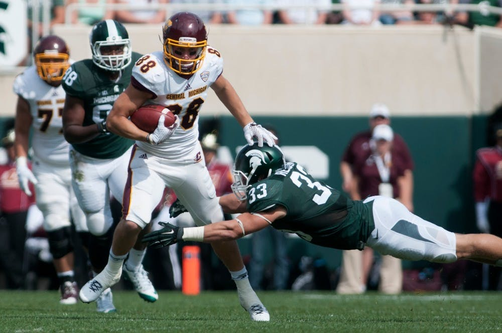 Sophomore linebacker Jon Reschke tries to tackle Central Michigan wide receiver Jesse Kroll in the second quarter during the game against Central Michigan on Sept. 26, 2015, at Spartan Stadium. The Spartans defeated the Chippewas, 30-10. Julia Nagy/The State News