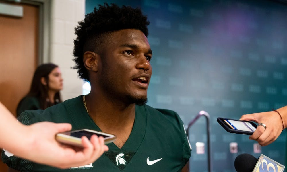 <p>Junior linebacker Brandon Bouyer-Randle speaks to the press during Michigan State's Football Media Day at Spartan Stadium on Aug. 5, 2019. </p>