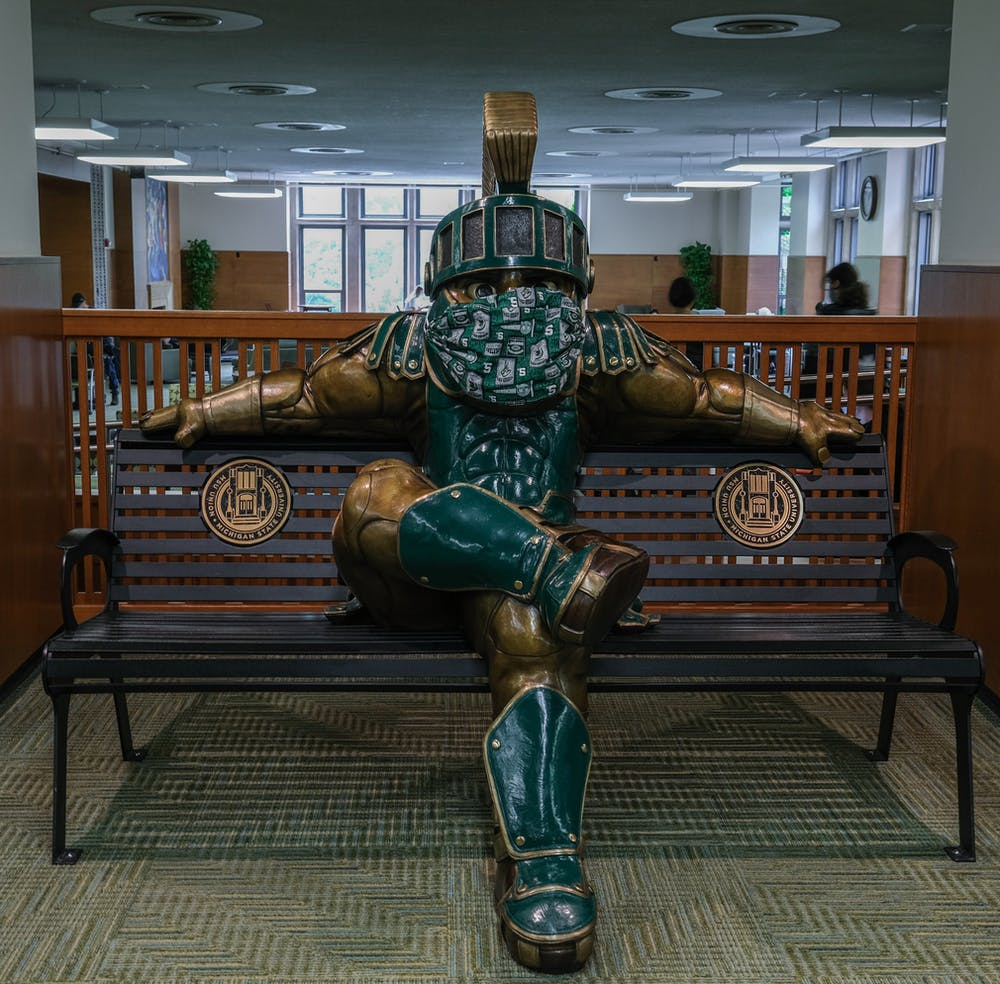 <p>Sparty statue with a mask in the MSU Union on Sept. 15, 2020.</p>