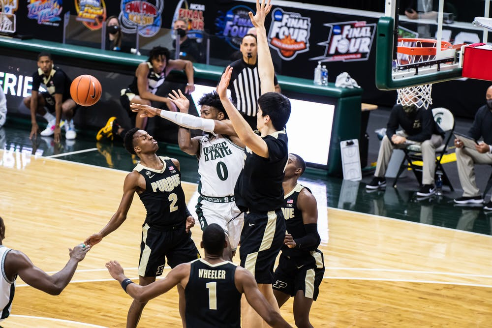 <p>Junior forward Aaron Henry is swarmed by Purdue defenders in the paint during the Spartans&#x27; 55-54 loss to Purdue on Jan. 8.</p>