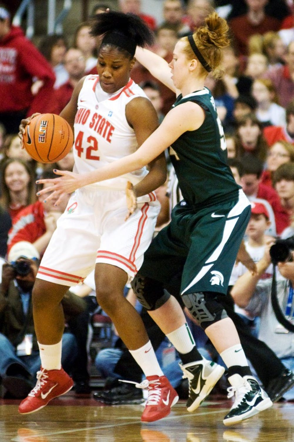 Redshirt-freshman center Kelsey Smith puts the pressure on Ohio State center Jantel Lavender on Sunday at Value City Arena in Columbus, Ohio. Kat Petersen/The State News
