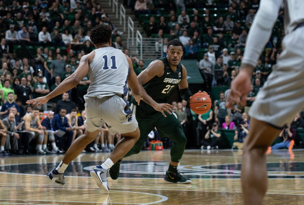 <p>MSU forward Xavier Tillman (23) dribbles during a basketball game against Penn State at the Breslin Center on Feb. 4, 2020. The Spartans fell to the Nittany Lions, 70-75.</p>