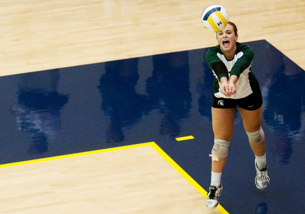 Freshman libero Kori Moster serves the ball against U-M. The Spartans lost to the Wolverines, 3-1, on Wednesday evening at Cliff Kreen Arena in Ann Arbor. Josh Radtke/The State News