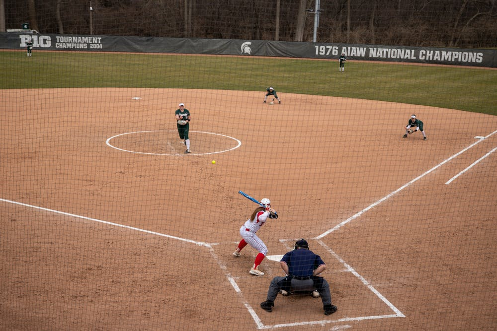 Alli Walker (19) pitching to Kiersten Withstandley (33) in the game against the Rutgers Saturday, Mar. 27, 2021 in East Lansing at Secchia Stadium.