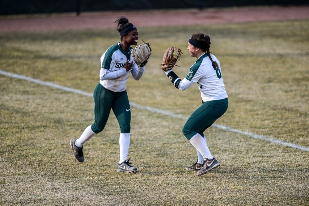 Senior outfielder Ebonee Echols (3) celebrates with teammate senior third baseman Kaitlyn Eveland (8) during the game against Oakland on April,3, 2019 at Secchia Stadium. The Spartans beat the Golden Grizzlies, 10-3   .