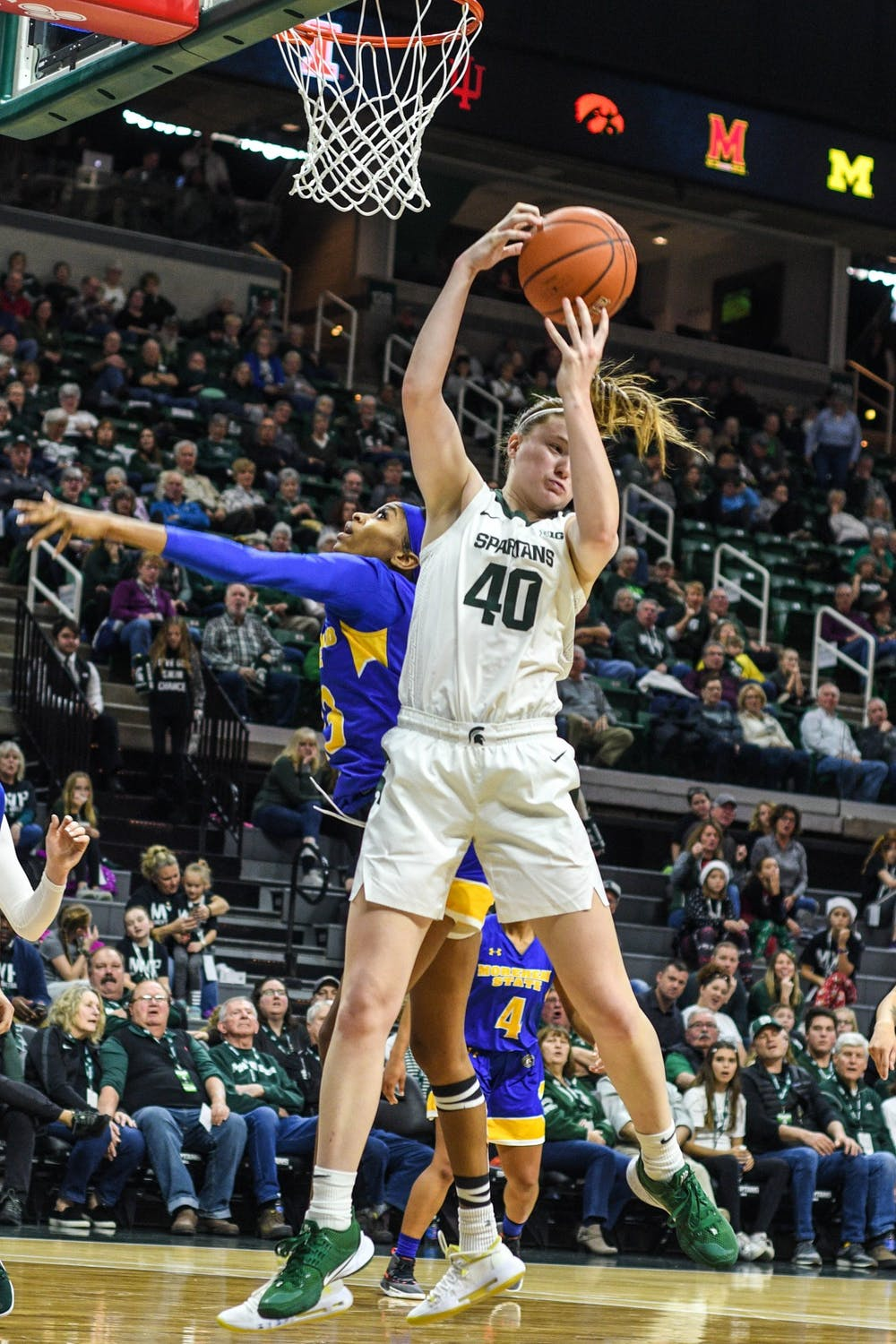 <p>Freshman guard Julia Ayrault (40) shoots the ball during the game against Morehead State on Dec. 15, 2019 at Breslin Center. The Spartans defeated the Eagles, 93-48.</p>
