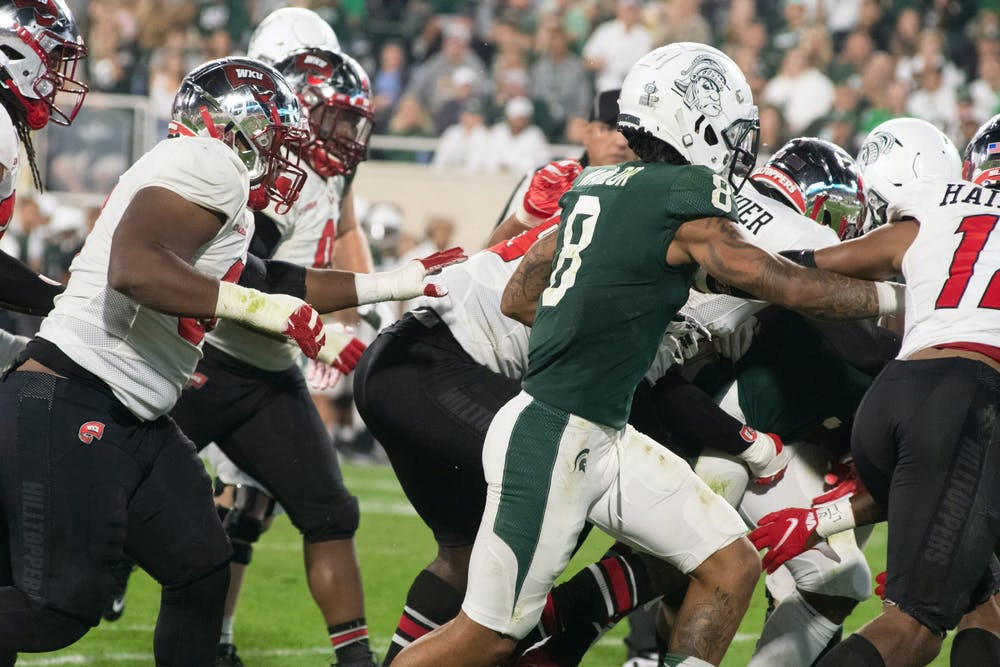 <p>Redshirt junior wide receiver Jalen Nailor takes control of the ball during MSU&#x27;s game against Western Kentucky. </p>