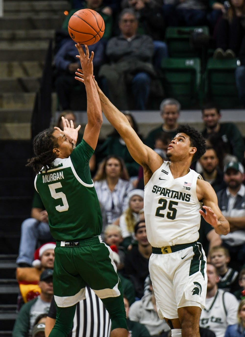 <p>Then-freshman forward Malik Hall (25) contests a shot during the game against Eastern Michigan on Dec. 21, 2019, at the Breslin Center. The Spartans defeated the Eagles, 101-48.</p>