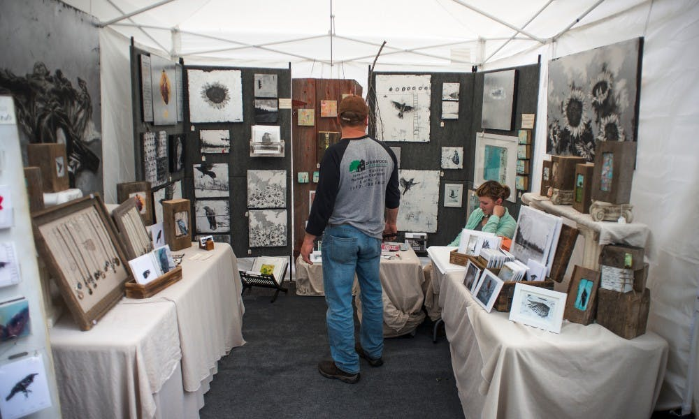Lansing resident Ingrid Blixt's tent is pictured during the East Lansing Art Festival on May 21, 2017. The East Lansing Art Festival is an event meant to bring the East Lansing community together through appreciation of art.