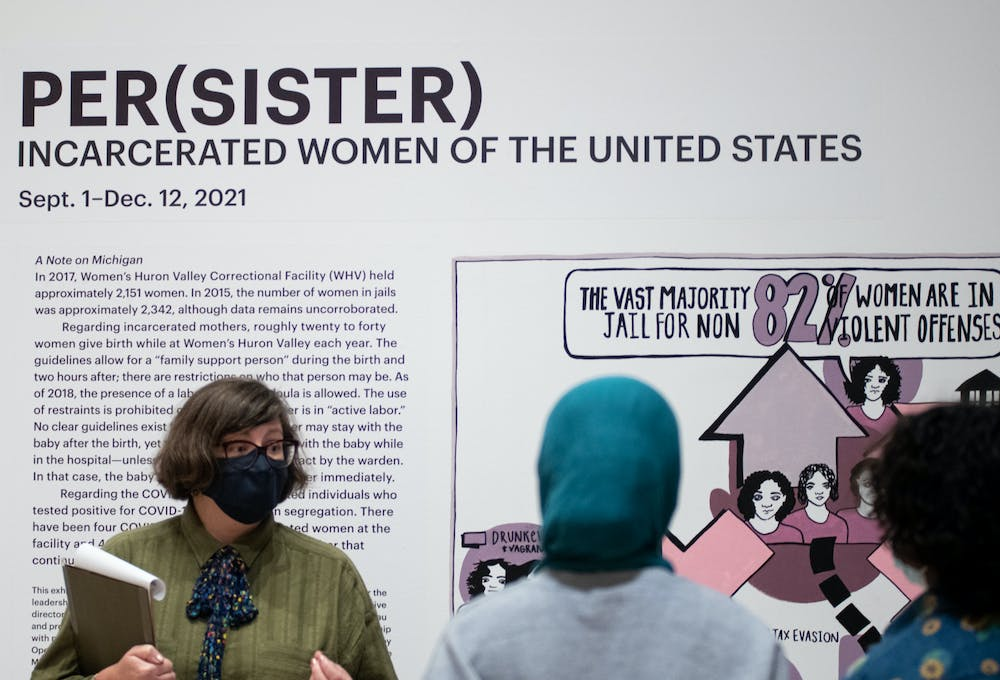 <p>Tour guide Michelle Word explains the Per(sister): Incarcerated Women of the United States exhibit during a guided tour at the Broad Art Museum on Sept. 22, 2021.</p>