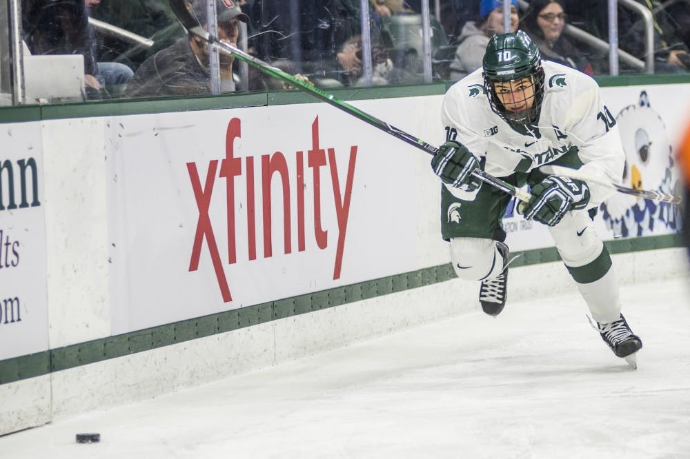 Sophomore center Sam Saliba (10) chases after the puck during the first period of the men's hockey game against Ohio State on Jan. 5, 2018 at the Munn Ice Arena. (Nic Antaya | The State News)