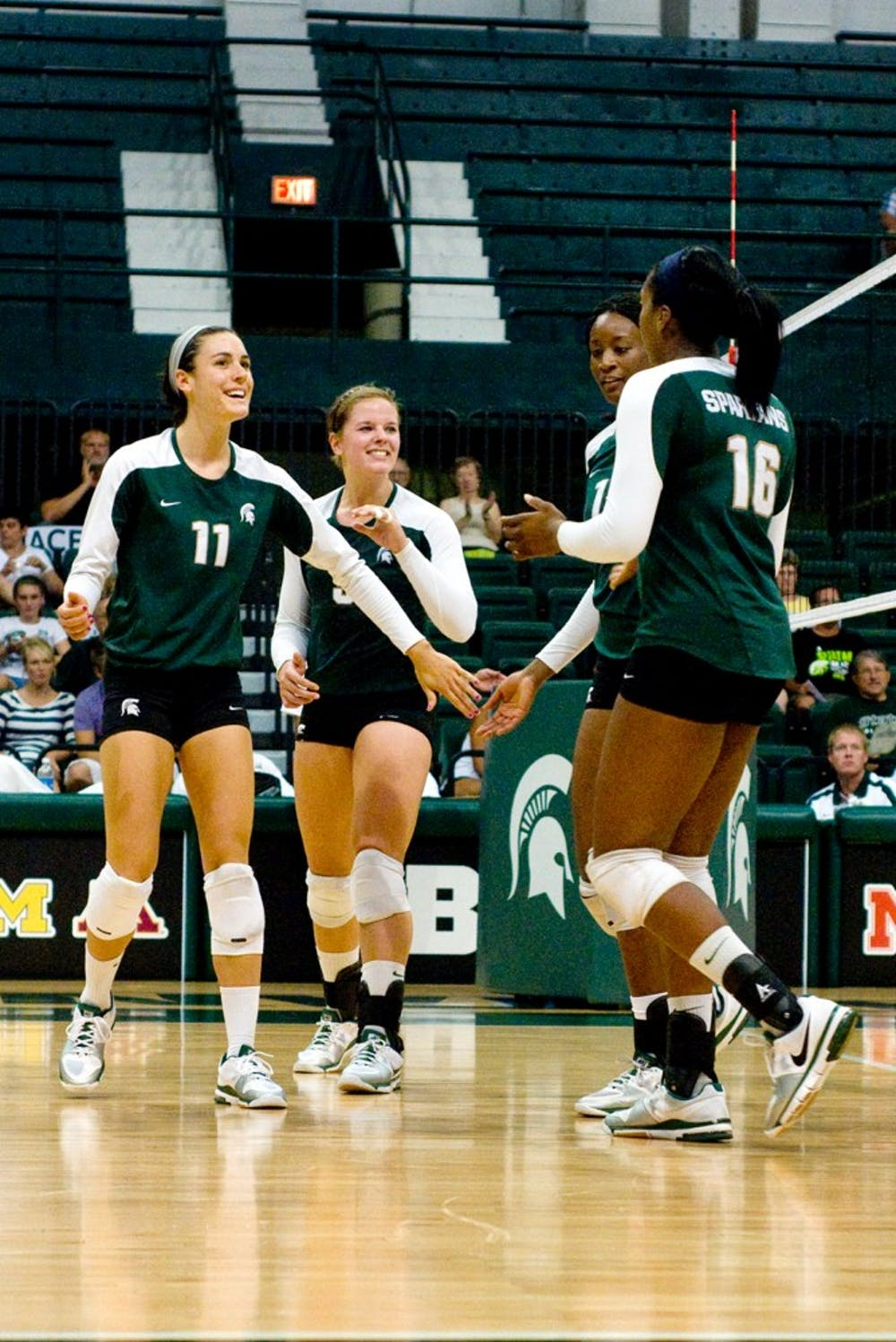 <p>From left to right, senior outside hitter Becca Zlabis, senior outside hitter and middle blocker Jenilee Rathje, freshman middle blocker Jazmine White, and senior outside hitter Kyndra Abron celebrate after gaining control of the ball on Saturday during the Spartan Showcase. The ladies beat the Cleveland State Vikings 3-0.</p>