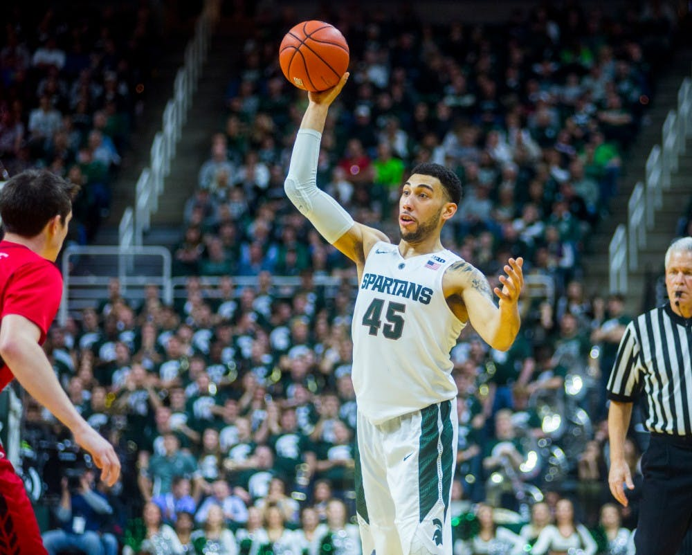 Senior guard Denzel Valentine looks to pass during the second half of the game against Rutgers on Jan. 31, 2016 at Breslin Center. The Spartans defeated the Scarlet Knights, 96-62.