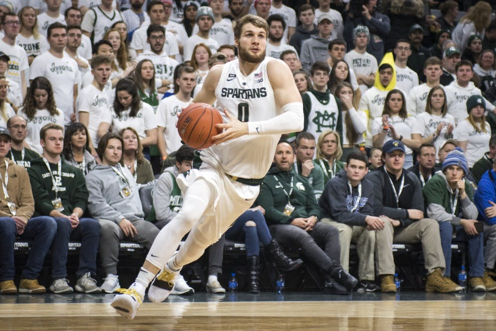 <p>Junior guard Kyle Ahrens (0) drives to the net during the men&#x27;s basketball game against Indiana Feb. 2, 2019 at Breslin Center. Nic Antaya/The State News</p>