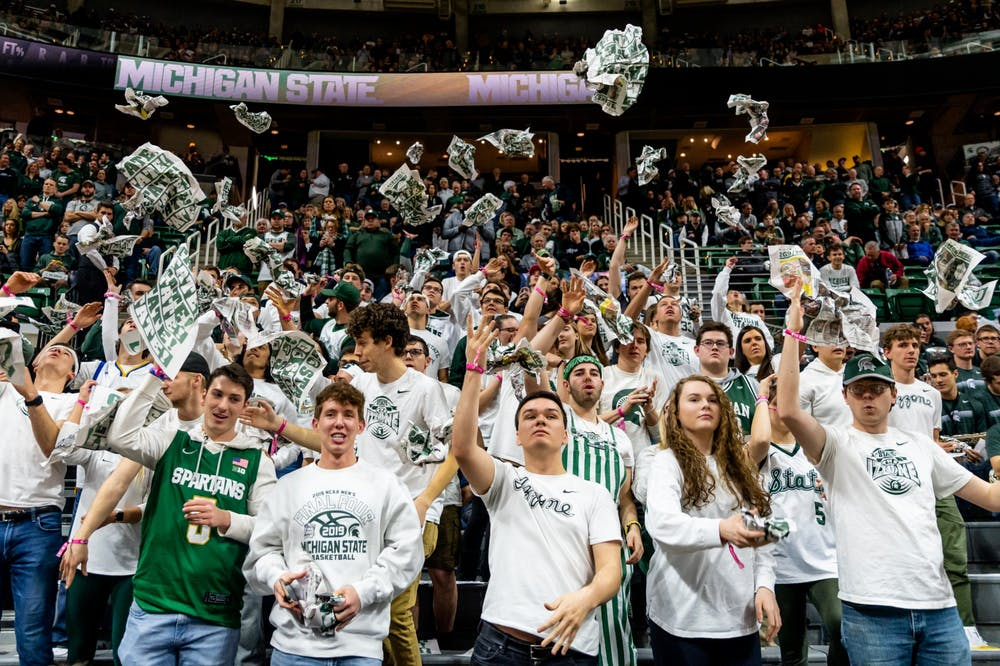 <p>Members of the Izzone toss newspapers into the air before a game against Iowa. The Spartans defeated the Hawkeyes, 78-70, at the Breslin Student Events Center on Feb. 25, 2020. </p>