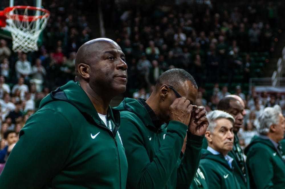 """<p>MSU basketball legend Earvin """"Magic"""" Johnson and other members of the 1979 national champion basketball team on the court before MSU vs. Minnesota. MSU beat Minnesota 79-55 at the Breslin Center on Feb. 9, 2019.</p>"""