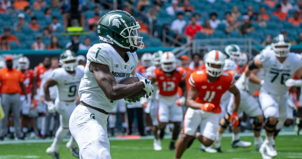 <p>Redishirt junior wide receiver Jayden Reed (1) catches the punt from Miami in the first quarter. </p>