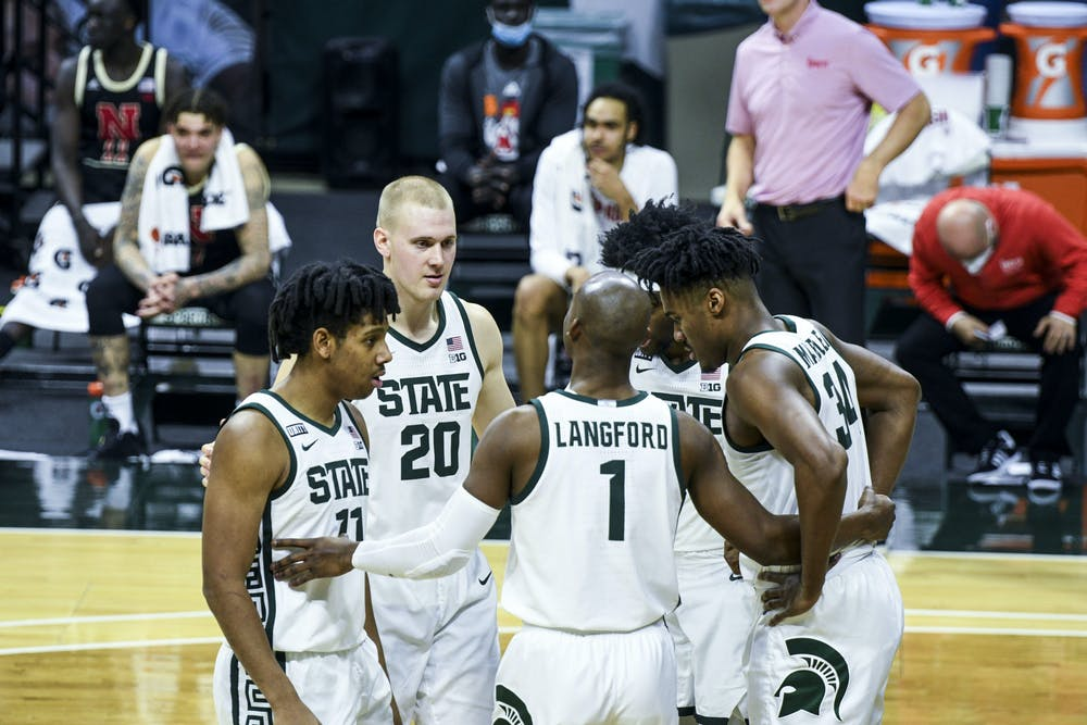 Grad student guard Joshua Langford (1) talks to his team before a free-throw during the game against Nebraska on February 6, 2021 at the Breslin Center. The Spartans defeated the Cornhuskers 66-56.