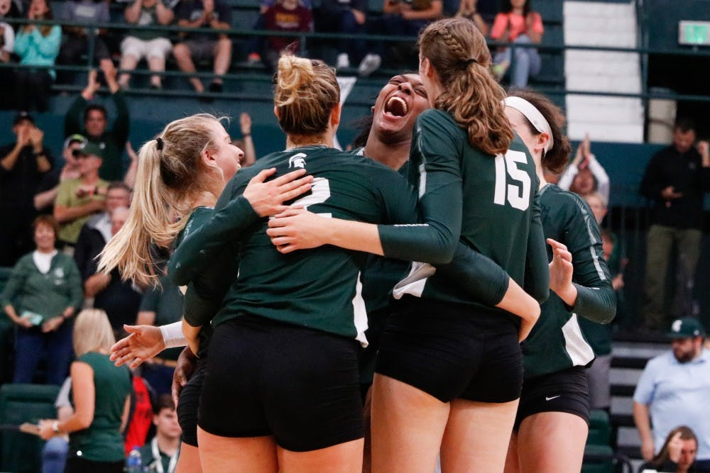 <p>The Spartans celebrate winning a set during the game against Cincinnati on Sept. 6, 2019 at Jenison Fieldhouse. The Spartans defeated the Bearcats, 3-1.</p>