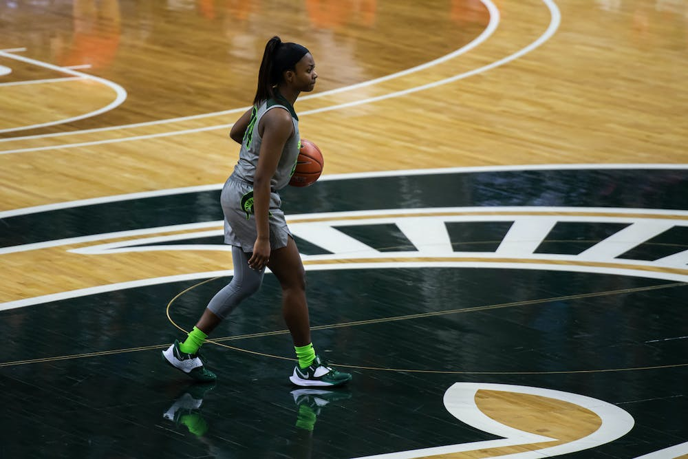 <p>Junior guard Nia Clouden takes the ball up court during a matchup with Maryland on Jan. 7, 2021.</p>