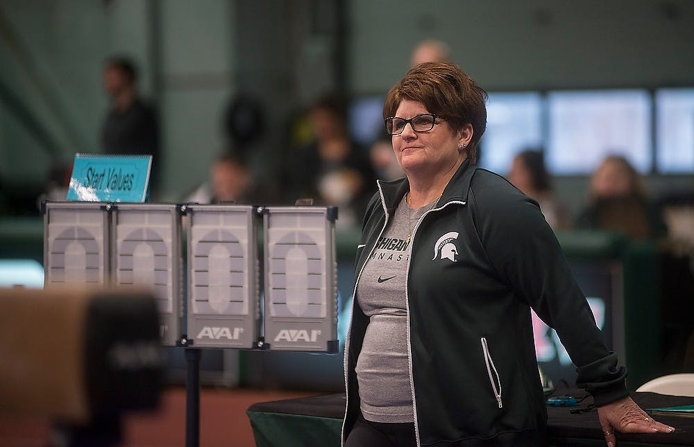 <p>Head coach Kathie Klages watches the team warm up for beam on Feb. 13, 2015, at the women's gymnastics meet against Michigan. Michigan defeated Michigan State with a score of 196.725-194.850. Emily Nagle/The State News</p>