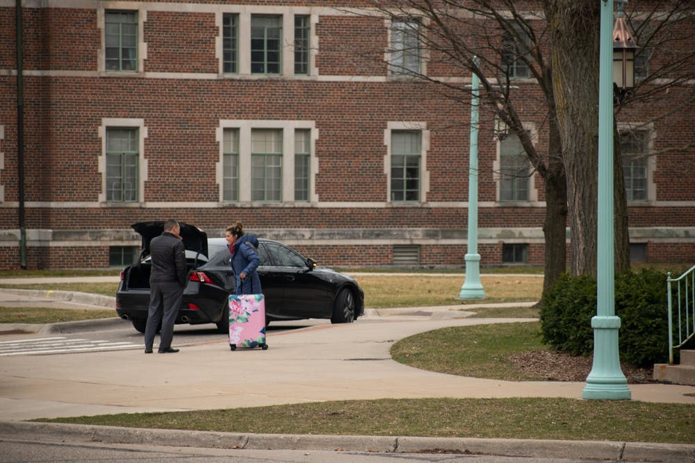 <p>An MSU student begins the process of leaving campus after MSU halted in-person classes due to the coronavirus March 11, 2020.</p>