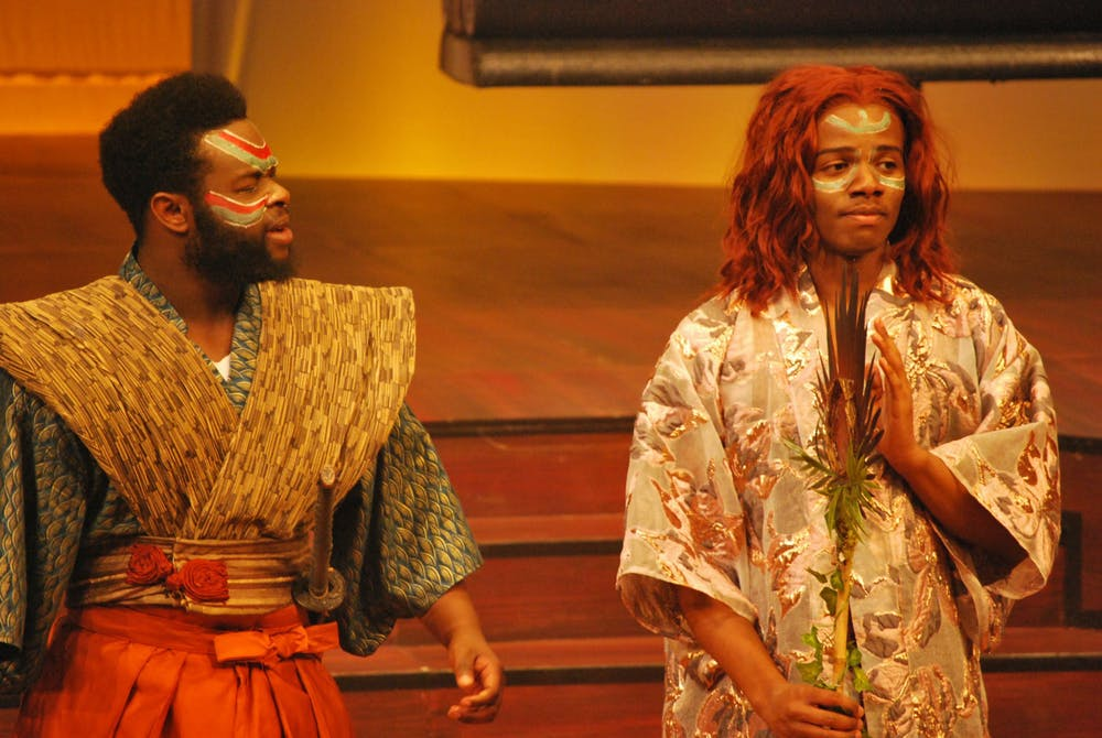 <p>(From left to right) Fine Arts students Tino Gilmore and Jay Gooden perform in The Bacchae production in April of 2019 (Photo courtesy of Jay Gooden).</p>