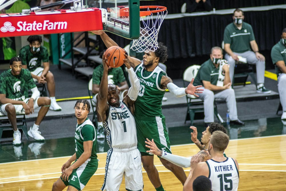 <p>Masters guard Joshua Langford (1) fights for the ball during the game against Eastern Michigan on Nov. 25, 2020 at the Breslin Center. The Spartans defeated the Eagles, 83-67.</p>