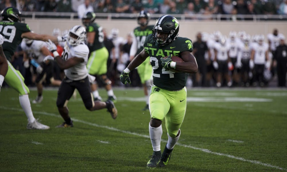 <p>Redshirt freshman Elijah Collins (24) runs the ball down the field in their game against the Broncos at Spartan Stadium on Sept. 7, 2019.</p>